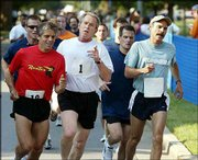 Promoting physical fitness for government workers, President Bush sets the pace for 400 White House staff members in a three-mile run at Fort McNair in Washington. Bush on Saturday also urged Americans to get into an exercise routine.