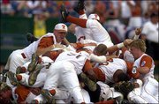 Texas players celebrate after winning the College World Series championship. The Longhorns held off South Carolina, 12-6, on Saturday in Omaha, Neb.