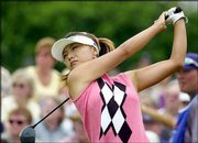 Mi Hyun Kim tears into a tee shot on Saturday in New York.