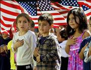 "Students at Nevada Avenue Elementary School recite the Pledge of Allegiance as part of October 2001 nationwide ceremonies to honor America in the Canoga Park district of Los Angeles&squot; San Fernando Valley. For the first time ever, a federal appeals court Wednesday declared the Pledge of Allegiance unconstitutional because of the words ""under God"" added by Congress in 1954. The ruling, if allowed to stand, means schoolchildren can no longer recite the pledge, at least in the nine Western states covered by the court."