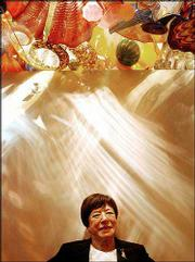 "Myra Janco Daniels poses below ""The Persian Ceiling"" by Dale Chihuly at the Naples Museum of Art in Naples, Fla."