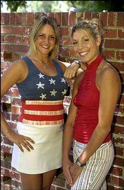 Britches Clothing sales associates Lori Jorgenson, a Kansas University senior from Northbrook, Ill., left, and Andrea Yarbrough, a KU junior from El Dorado, model some patriotic styles from the store at 843 Mass.