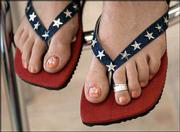 An array of patriotic-style red, white and blue clothes and accessories are available in Lawrence stores. These denim thong sandals by Usindo featuring star sequins and beads are from Saffees, 911 Mass.