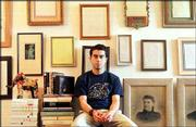 "Author Jonathan Safran Foer, 25, sits in his apartment in the Queens borough of New York. His book, ""Everything Is Illuminated,"" quickly made the New York Times&squot; best-seller list."