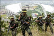 South Korean military soldiers patrol near the World Cup Stadium in Daegu, south of Seoul, after North and South Korean warships exchanged fire near the western sea border. A World Cup third-place playoff between South Korea and Turkey was due to start later Saturday at this stadium. At least four South Korean sailors died, 22 were wounded and one was missing in the most serious border clash in three years.