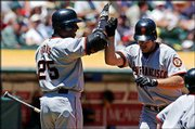 San Francisco Giants Outfielder Barry Bonds, Left, greets Jeff Kent at home plate after Kent hit a two-run home run against the Oakland Athletics on Saturday in Oakland. Bonds is one of few sure bets for this season's All-Star game.