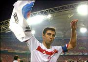 Turkey's Hakan Sukur waves a South Korean flag. Turkey won the third-place World Cup match, 3-2, on Saturday in Daegu, South Korea. Story on page 8C.