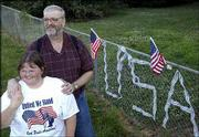 With the letters U-S-A woven into their fence, Dan and Hollyce Morris put their patriotism on display at the intersection of Kasold Drive and Eighth Street. The Morrises erected the display after the Sept. 11 attacks, and on Tuesday they said they had no plans to take it down. For the Fourth of July holiday, the Morrises said they most likely just would relax and enjoy the day.