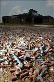 Thousands of spent firecracker casings litter the Prairie Park School parking lot after Independence Day. Lawrence city commissioners say they'll reconsider the city's fireworks ordinances.