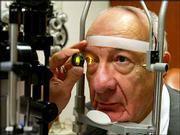 Ernest Hayeck, 77, has his eye's retina examined during a check-up in Boston. After four treatments with the experimental drug rhuFab to treat his macular degeneration, Hayeck's sight went from 20-100 to 20-20, with his glasses on.