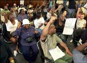Inglewood, Calif., residents protest inside the Inglewood City Hall against Police Officer Jeremy Morse's abusive treatment of 16-year-old Donovan Jackson, which was recorded on videotape. The mayor of Inglewood, Roosevelt Dorn, on Tuesday said Morse should be fired.