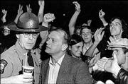 "Vern Miller, second from left, finds himself in the middle of a crowd of Kansas University students during a campus protest of the Vietnam War in this file photo from the early 1970s. Miller, Kansas attorney general from 1971 to 1975, campaigned on promises to ""leap into the drug-ridden hippie communes of Lawrence with both feet."" Carla Stovall is Kansas' first female attorney general. She is not seeking re-election."
