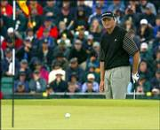 South Africa's Ernie Els watches as his ball comes up short of the pin after playing from off the 14th green. Els shot a 5-under-par 66 during the second round of the British Open on Friday at Muirfield golf course in Gullane, Scotland.