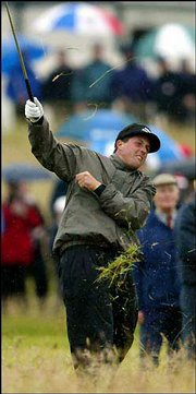 Phil Mickelson of the United States grimaces after playing out of the rough on the first hole Friday.