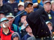 Tiger woods plays an iron shot during Friday's round of the British Open at Muirfield golf course.