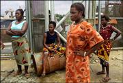 Nigerian women occupy the ChevronTexaco oil flowstation at Abiteye, Nigeria. Friday the women took two oil workers hostage to force the company to negotiate.