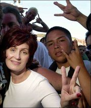 Surrounded by fans, Sharon Osbourne, attends Ozzfest in Devore, Calif., in this, June 30, 2001 file photo.