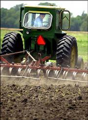 Jim Keating, Bennington, uses a spring-tooth harrow to control weeds on some of his land just south of the city. Keating and his wife, Sue, are organic farmers.