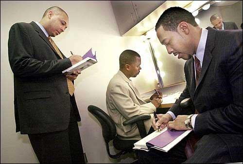 Photo: George Jenkins, left, Rameck Hunt and Sampson Davis sign ...