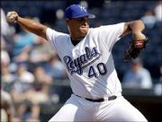 Kansas City starting pitcher Runelvys Hernandez picked up his first career victory in the first game of a doubleheader in Kansas City, Mo. Hernandez was a 7-5 winner Saturday, allowing three runs and seven hits in seven innings. Kansas City lost the second game 5-3, ending its nine game win streak.