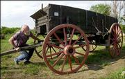Don Werner works on a covered wagon outside his shop in Horton. Werner is one of a handful of wagonmakers, or wainwrights, across the nation. He produces the wagons full time for ranches, tourist attractions and living history farms.