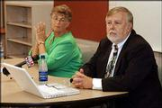 Marilyn Layman, superintendent of the DeSoto school district, and Charles Stallard, adjunct associate professor of educational technology at George Washington University, listen as a parent expresses concern about technology initiatives at Shawnee's Riverview School.