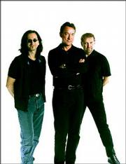 Members of Rush are, from left, Geddy Lee, Neil Peart and Alex Lifeson.