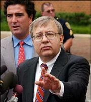Zacarias Moussaoui's standby lawyers, from left, Edward McMahon and Frank Dunham talk with reporters outside federal court in Alexandria, Va. Thursday, Moussaoui declared he was guilty of four of six charges accusing him of conspiring with the Sept. 11 hijackers, then withdrew his attempted plea after arguing with the judge.