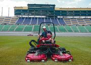Darin Furhman poses on his machine on the infield of the Kansas Speedway.