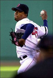 Boston's Pedro Martinez delivers against Tampa Bay. Martinez pitched two-hit ball through eight innings as the Red Sox blanked the Devil Rays, 6-0, Thursday in Boston.