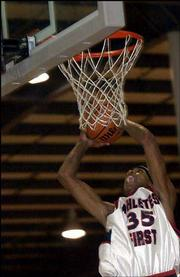 J.R. Giddens dunks during an AAU tournament game. A Kansas University recruit, Giddens had 32 points in a second-round game Saturday in Shawnee.