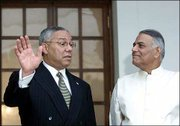 U.S. Secretary of State Colin Powell, left, speaks with Indian Foreign Minister Yashwant Sinha in New Delhi, India. Powell, beginning an eight-nation Asian tour, is prodding India and Pakistan to open a dialogue in hopes of resolving their differences over Kashmir.