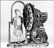 Saving money in this tricky cast-iron mechanical bank must have been fun in the 1890s. The little girl jumped her rope. Today the bank is a treasure, not a toy, and is worth more than $50,000.