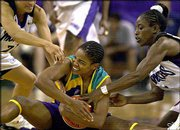 Los Angeles' Tamecka Dixon tries to protect the ball from Sacramento's Ticha Penicheiro, left, and Ruthie Bolton, right.