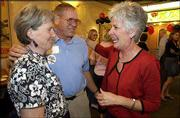 M.E. and Clete Grosdidier of Eudora, left, greet and congratulate Sandy Praeger on winning the Republican nomination for insurance commissioner. The three attended a primary results party Tuesday for Praeger at Massachusetts Street Delicatessen, 941 Mass.