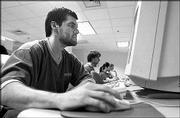 MANUEL PEREZ-TEJADA, a KU doctoral student in film, works in a computer lab on the fourth floor of the Kansas Union.