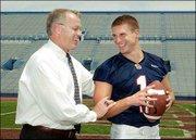 Kansas athletic director Al Bohl, left, and KU receiver Harrison Hill yuk it up.