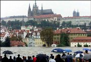 Onlookers crowd the riverbank to look at the swollen Vltava river in Prague, Czech Republic. Tens of thousands of Czechs fled their historic capital for higher ground Tuesday in the worst flooding in more than 100 years.