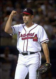 Atlanta's John Smoltz reacts after San Francisco's Rich Aurilia grounded into a double play in the eighth inning. Smoltz earned his 42nd save Wednesday in the Braves' 1-0 victory at Atlanta.