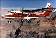 A tour plane flies over the Grand Canyon in this undated file photo. A federal appeals court said Friday that rules limiting the number of small aircraft flying over the Grand Canyon aren't strict enough.