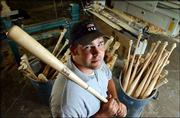 Sparky Wilhelm, a former Kansas University baseball player, works at Diamond Cabinetry and Wood Products in Lawrence. Wilhelm and Calvin Ledbetter created the company that makes, among other things, wood bats.