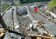 An employee of the German railway walks on damaged tracks in Dresden-Felsenkeller, eastern Germany. Many railway lines near Dresden were destroyed by floods of the Elbe River that devastated huge parts of Dresden and the German state of Saxony. More than 100 people have been killed in the floods in the last week.