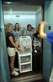 KU students pack into available dorm elevators at Oliver Hall as they make their move into the residence hall. Residence halls opened for students Sunday.