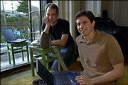 Because of hills and other apartment buildings, Dan Augustine, left, and Jason Luther are obstructed from creating a wireless network between their two houses. Meanwhile, the two provide wireless access points for their neighbors in San Francisco to use by hanging them from their balconies or keeping them close to windows.