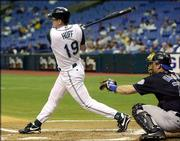 Tampa BAy's Aubrey Huff, left, hits a solo home run in the first inning against Kansas City. Huff was 3-for-5 with 3 RBIs in the Devil Rays' 8-6 victory against the Royals.