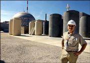 U.S. security experts fear that terrorists may target nuclear waste stored at reactors throughout the country. Plant official Robert Hovey stands outside the Dresden reactor near Joliet, Ill., where about 15,000 tons of waste are stored.