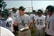 Free State coach Bob Lisher started preseason practices with their respective teams on Monday. The high school season begins Sept. 6.