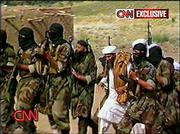 This view from from undated video showing Osama bin Laden, with a detail of bodyguards, is part of a cache of videotapes that CNN acquired in Afghanistan that purport to show al-Qaida terror training, bomb-making and poison gas experiments.