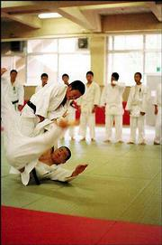 Sloan turns her camera lens on a judo class at Goryogadai High School during the visit to Hiratsuka, Japan.