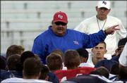 KU coach Mark Mangino speaks to the Jayhawks after Wednesday's scrimmage.